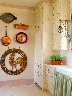 Vintage copper pieces add a rustic feel to this cottage kitchen. More ideas for flea market finds: http://www.bhg.com/decorating/do-it-yourself/wall-art/diy-wall-art/?socsrc=bhgpin040113coppercookware