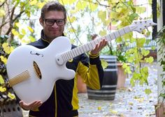 Jens Ritter Princess Isabella Baritone Guitar held by Jens Ritter!