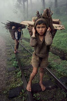 00544_05. Bangladesh, 1983, BANGLADESH-10014. Young boys carry wood.  Retouched_Ashley Crabill 05/28/2013
