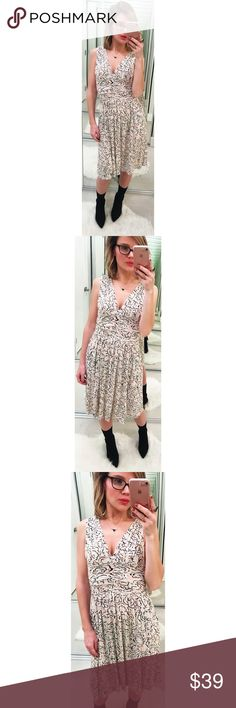 Anthropologie Deletta Cloudrose Dress Ruched jersey dress with a cloud-like floral print. Gathered, double v-neck. Cream, black and orange. Rayon/spandex. 💕Offers welcome on single items and on bundles. Take 20% off your bundles automatically at checkout. Happy Poshing!💕 Anthropologie Dresses Midi