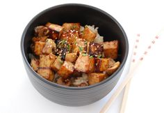 Cubes of tofu are marinaded in a mixture of soy sauce, maple syrup, ground ginger, sesame oil, and rice vinegar, and then baked in the oven until firm and crispy.