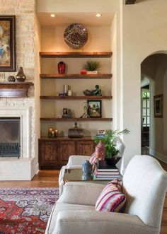 Spanish Colonial meets traditional in a beautifully styled Texas home. I like the warm lighting above the open shelving. You are in the right place about home decor styles eclectic Here we offer you t Living Room Interior, Home Living Room, Home Interior Design, Living Room Designs, Spanish Living Rooms, Mediterranean Living Rooms, Spanish Home Decor, Spanish Style Homes, Spanish Style Interiors