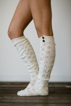 I love these boot socks. I love that they are knit with the little buttons at the top that would peep through if you wore boots. They are a fun addition to an outfit.