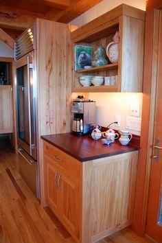 Jarrah an exotic, reclaimed hardwood, tops custom beech cabinets.