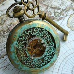 wasbella102:    Key and old pocket watch