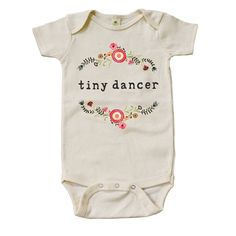 """Mini + Meep """"Tiny Dancer"""" Onesie is grown, fair sewn and designed with love in the USA. Made from 100% soft organic cotton and printed with eco-friendly water based inks, this onesie meets Global Organic Textile Standards and is produced without the use of harmful chemicals, pesticides, or artificial dyes. 10% of all proceeds go to UNICEF's Children Fund to help children in need."""