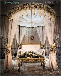 Absolutely love this elegant wedding décor | white drapery and dark green and white floral decorations | Nikkah Ideas | Muslim Weddings | Credits: weddingfeferity | Every Indian bride'sFav. Wedding E-magazine to read. Here for any marriage advice you need |www.wittyvows.comshares things no one tells brides, covers real weddings, ideas, inspirations, design trends and the right vendors, candid photographers etc.