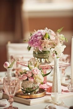 Vintage wedding reception table decor. Light pink, gold with a cute use of frames.