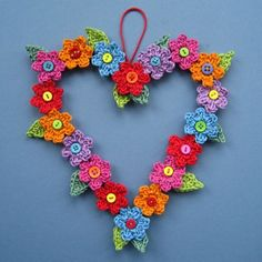 Valentine Sweet Heart - free crochet flowered heart pattern by Lucy. What better way to celebrate springtime than to crochet flowers? This roundup of free patterns includes crochet flower appliqués, floral crochet squares and other flower crochet ideas. Appliques Au Crochet, Crochet Motifs, Crochet Flower Patterns, Crochet Flowers, Crochet Designs, Leaf Patterns, Crochet Leaves, Crochet Home, Crochet Crafts