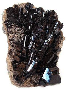 Fluor-Buergerite, a mineral belonging to the tourmaline group.      Cali Elliott via Kelly Rish onto Rocks, & Gems, & Minerals, Oh My...
