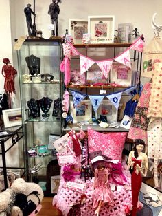 Shop display at life's little larks in Preston, featuring a variety of handmade artists ..