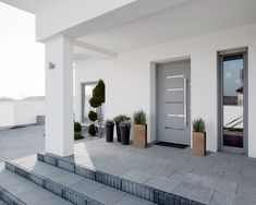 Modern white house with light blue front door modern front door colors modern farmhouse front door Modern Entrance, Modern Front Door, House Entrance, Led Outdoor Wall Lights, Outdoor Walls, Decoration Facade, Front Door Colors, Home Landscaping, Selling Your House