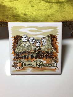 A personal favorite from my Etsy shop https://www.etsy.com/listing/486597286/vintage-mount-rushmore-decorative-tile