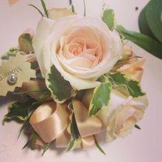 Spray rose corsage with light greens