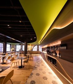 Design firm LAVA have designed Olio, a Sicilian restaurant in Sydney, that uses recessed LED lights to highlight various areas throughout the restaurant and create a nice warm modern glow.