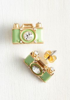 Lens is More Earrings. Pixel this - accessorizing with these gold camera earrings! #mint #modcloth