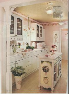 shabby pink kitchen. Notice the painted design on the end of the kitchen island cabinet!!!! Loooove