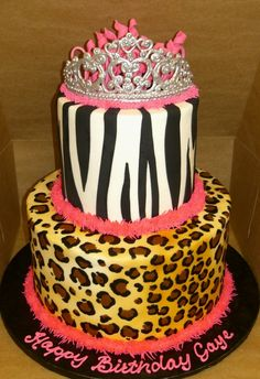 """a 6"""" and 10"""" cake with 5.5"""" tiers.  Iced in buttercream, black fondant zebra stripes.  RI tiara.   the single tier shows how i did the print, then what it was like before i airbrush ivory over the print. Each tier is 3 layers of cake."""