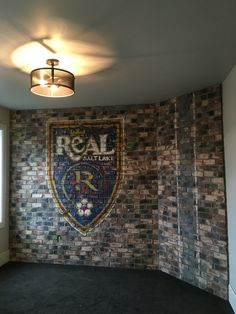 Real Salt Lake logo painted on brick wall for the Parade of Homes.