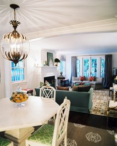 Hollywood Regency Vintage Lighting: An open living-dining space with a mix of vintage furniture.