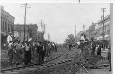 Laying Street Car Tracks on Bank St. ` by Decatur Public Library, via Flickr
