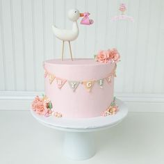 Adorable Stork Baby Shower Cake by Little Hunnys Cakery as featured on MyCakeSchool.com's Roundup of Baby Shower Cake Ideas!