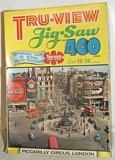 Vintage Tru-View Jigsaw Puzzle – Piccadilly Circus, London (1960s)    Lovely vintage jigsaw puzzle by Tru-View depicting Piccadilly Circus from the 1960s. Over 400 interlocking pieces, and reproduced from an actual photograph.   £4.99
