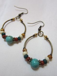 Hey, I found this really awesome Etsy listing at https://www.etsy.com/listing/166736118/hoop-earrings-turquoise-handmade-beaded