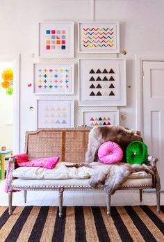 Love play of the elegant couch with the super simple contemporary framed art, stipped rugs and pops of color in pillows