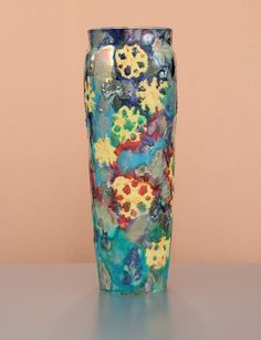 """Paul Katrich """"Winter Turns To Spring"""" Luster Vessel. Marked with Katrich Logo. Mint condition. 13 1/2"""" tall Estimate $1000-$1500. This lot is a donation to the American Art Pottery Association with 100% of the hammer price and buyers premium going to support the important work of the AAPA. From Paul: """"Snow crystals of amber flame fall through chromatic hues of scarlet, emerald, turquoise and lapis blue. The iridescent, silken matte glazes are interspersed with touches and flows of bright…"""