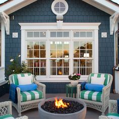 White Wicker With Bright Pillows are Perfect in This Cape Cod Style Setting