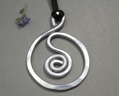 Aluminum Spiral in a Circle Pendant via Etsy.