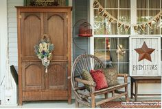 If it is more of a country primitive style you are looking for to show your flair...why not bring an armoire onto your porch. I would make sure that it was in a safe place on a porch with a roof...but it does look great!