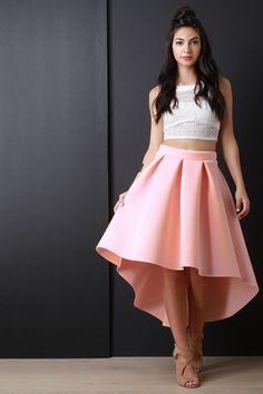 This skirt features a wide waist band, large box pleated construction, a-line cut, and a high low hemline. Accessories sold separately. Made in U.S.A. 92% Polyester, 8% Spandex. Measurement Size Waist