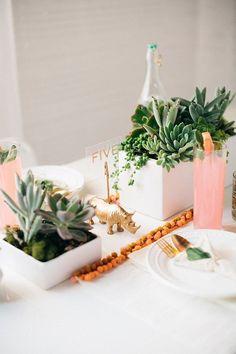 A bright pom-pom trim looks extrafestive next to succulents in modern, white pots.  Photo by Kimberly Chau via Sugar and Cloth