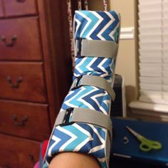 Chevron blue fabric that I tucked into my medical walking boot. Attach Velcro to secure in place. Easily removed and washable.