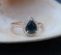 The ring features 1.58ct Peacock Blue Green sapphire. The stone is eye clean and sparkling, natural untreated sapphire.  Size 6  Details: Main