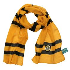 This lightweight scarf features the yellow and black Hufflepuff color scheme and a Hufflepuff crest patch on one end. Sheer and translucent, it will bring a whole new sense of style to your Harry Potter apparel collection! Spot clean only. Harry Potter Scarf, Harry Potter Shop, Harry Potter Style, Harry Potter Outfits, Harry Potter Hogwarts, Light Scarves, Lightweight Scarf, Scarf Styles, Fashion Brands