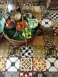 This is the floor in a restaurant in Hoi An, Vietnam - I love the way these different patterned tiles work together!