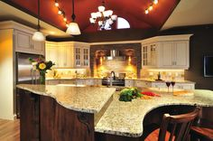 Here is a well done kitchen island with two levels. Great design and execution here.