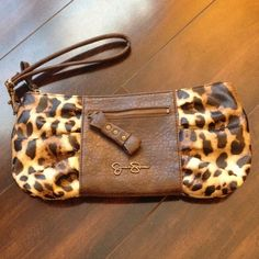Brand New Jessica Simpson Clutch You will absolutely LOVE this Jessica Simpson clutch. This clutch was purchased and never used! Holds a lot and made of quality material! Very cute animal print. No holes, stains, or tears. Smoke free home. Jessica Simpson Bags Clutches & Wristlets