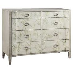 "8-drawer chest with a hand-painted washed grey finish and floral detail.  Product: ChestConstruction Material: MDFColor: Washed greyFeatures:  Eight drawersHand-painted Dimensions: 40"" H x 48"" W x 18"" D"