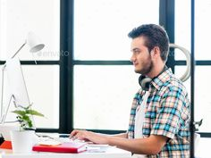 Young man working in office by nexusplexus. Price $5