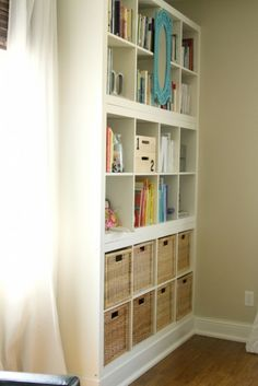 DIY Ikea hack shelves stacked in top of each other to make a bookshelf. But I would ombre the shelves.