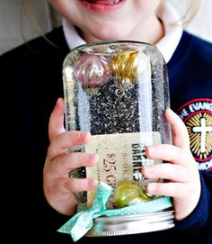 Blogger Bree Hester used a Mason jar filled with water to create a snowglobe that doubles as a gift card holder.