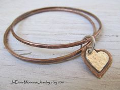 Copper bangles with sterling silver and copper hand cut heart which can be personalized $49. by JoDeneMoneuseJewelry