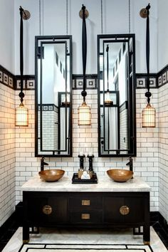 Hotel Siam. White subways with black grout. Hanging pendants. Framed mirrors.