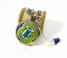 """Haberdashery: Liberty of London Grayson Perry """"Sissy"""" print fabric solid silver antique pendant set with Topaz & tiny Emerald stones by ohyouhandsomedevil on Etsy"""