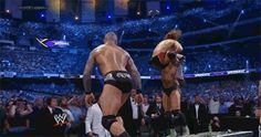 "Randy Orton & Batista pull off one of the most incredible moves on Daniel Bryan at WrestleMania XXX. A Batista Bomb into an RKO on the announce table. A true ""Holy Shit"" moment. #GIF"