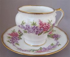 """Beautiful Porcelain Tea Cup and Saucer by Rosina Queens Pink and Blue Flowers design Fine Bone China - Made in England Cup is 3"""" tall Saucer is 5.5"""" in diameter Both in excellent condition, no chips or cracks. 